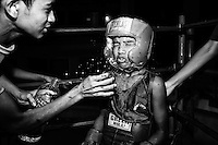 In the break of a boxing match at the Mohammad Ali Boxing stadium, Yasir [L] splashes water on his opponent face.