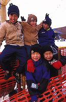 Native Alaskan children gather in a smiling, playful group. Alaska.