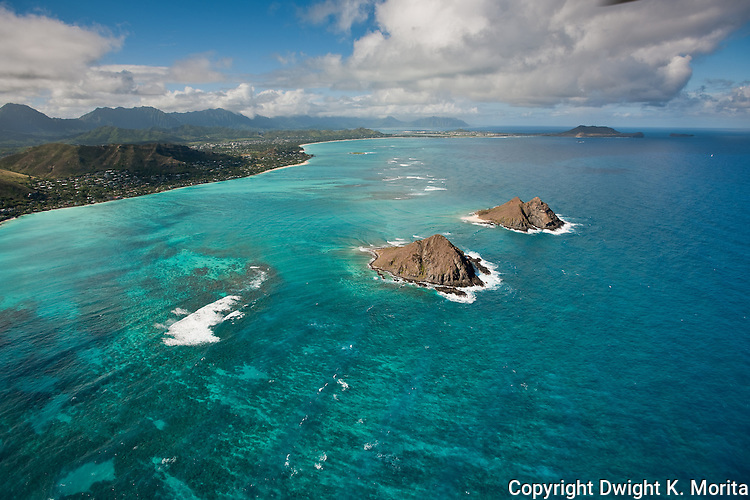 The Pacific Ocean surrounding the Mokulua Islands sparkles like a jewel in the afternoon sun.