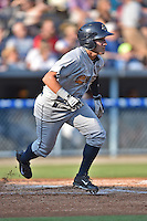 Charleston RiverDogs center fielder Mark Payton #6 runs to first during a game against the Asheville Tourists at McCormick Field July 26, 2014 in Asheville, North Carolina. The RiverDogs defeated the Tourists 8-7. (Tony Farlow/Four Seam Images)