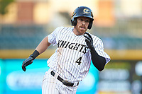 Charlie Tilson (4) of the Charlotte Knights hustles towards third base against the Toledo Mud Hens at BB&T BallPark on April 24, 2019 in Charlotte, North Carolina. The Knights defeated the Mud Hens 9-6. (Brian Westerholt/Four Seam Images)