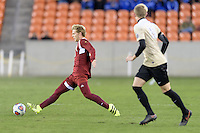 Houston, TX - Friday December 9, 2016: Alex Underwood (23) of the Denver Pioneers attempts to control a loose ball against the Wake Forest Demon Deacons at the NCAA Men's Soccer Semifinals at BBVA Compass Stadium in Houston Texas.