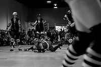 """San Francisco ShEvil Dead skater """"Kimfectious"""" takes a fall in the 2nd half of the Bay Area Derby Girls season opener at Dry Ice in Oakland, CA on April 26th, 2008. The ShEvil Dead lost to the Oakland Outlaws 66-103...(©Matt McKnight, 2008)"""