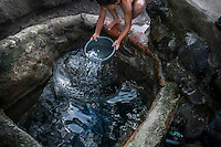 "November 07, 2014. ""Water it´s the real thing""<br /> A child takes water from a well contaminated in Nejapa (El Salvador). The people of Nejapa in El Salvador, have no drinking water because the Coca -Cola company overexploited the aquifer in the area, the most important source of water in this Central American country. This means that the population has to walk for hours to get water from wells and rivers. The problem is that these rivers and wells are contaminated by discharges that makes Coca- Cola and other factories that are installed in the area. The problem can increase: Coca Cola company has expansion plans, something that communities and NGOs want to stop. To make a liter of Coca Cola are needed 2,4 liters of water. ©Calamar2/ Pedro ARMESTRE"