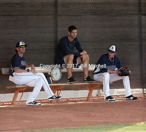 MacKenzie Gore (right) sits in the bullpen with pitching coach Pete Zamora (left) and pitching coordinator Mark Prior (center) before his first professional start for the AZL Padres at the Padres complex on July 17, 2017 in Peoria, Arizona (Bill Mitchell)