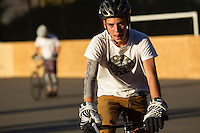 17 AUG 2014 - LONDON, GBR - A Partisans player leaves the court after defeat at the hands of Triple Jay at the 2014 London Open bike polo tournament in Highbury Fields in London, Great Britain (PHOTO COPYRIGHT © 2014 NIGEL FARROW, ALL RIGHTS RESERVED)