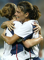 23 August 2004:  Mia Hamm celebrates with Heather O'Reilly after O'Reilly scored a goal during overtime against Germany during the semifinal game at Pankritio Stadium in Heraklio, Greece.     USA defeated Germany, 2-1 in overtime,  .   Credit: Michael Pimentel / ISI
