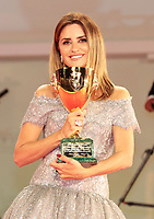 """VENICE, ITALY - SEPTEMBER 11: Penelope Cruz poses with the Coppa Volpi for Best Actress for """"Parallel Mothers"""" during the awards winner photocall during the 78th Venice International Film Festival on September 11, 2021 in Venice, Italy."""