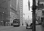 Pittsburgh PA:  View of a streetcar in front of the Union Trust Building on Grant Street.  Nearby buildings include; Oliver Building, Koppers Building, First English Evangelical Lutheran Church