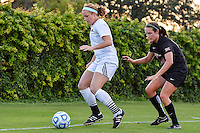 Texas State defender Brenna Smith (3) is defended by Texas defender Isabelle Kerr (14) during first period NCAA soccer game, Sunday, September 21, 2014 in San Marcos, Tex. Texas defeated Texas State 2-0. (Mo Khursheed/TFV Media via AP Images)