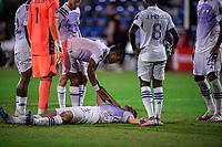 LAKE BUENA VISTA, FL - JULY 20: Robin Jansson #6 of Orlando City SC laying on the ground after a knock during a game between Orlando City SC and Philadelphia Union at Wide World of Sports on July 20, 2020 in Lake Buena Vista, Florida.