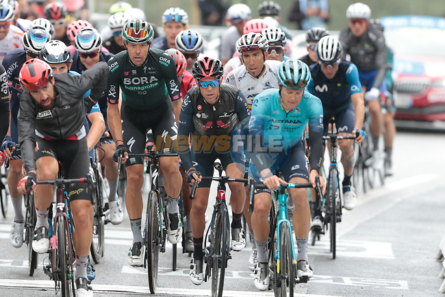 The peloton including Thomas De Gendt (BEL) Lotto Soudal, Jakob Fuglsang (DEN) Astana-Premier Tech, Richie Porte (AUS) Ineos Grenadiers and Daniel Oss (ITA) Bora-Hansgrohe crosses the finish line at the end of Stage 16 of the 2021 Tour de France, running 169km from Pas de la Case to Saint-Gaudens, Andorra. 13th July 2021.  <br /> Picture: Colin Flockton | Cyclefile<br /> <br /> All photos usage must carry mandatory copyright credit (© Cyclefile | Colin Flockton)