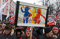 Moscow, Russia, 13/01/2013..Thousands of opposition protesters carried posters of President Vladimir Putin and members of the Russian parliament with the word ?Shame? written in red at a protest called the March Against The Scoundrels. The protest was against the new law banning the adoption of Russian children by Americans, widely seen as a response to the recently passed USA Magnitsky Act.