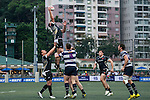 KIR Club Pyrenees (in black) plays against Natixis HKFC (in black and white stripes) during GFI HKFC Rugby Tens 2016 on 06 April 2016 at Hong Kong Football Club in Hong Kong, China. Photo by Juan Manuel Serrano / Power Sport Images