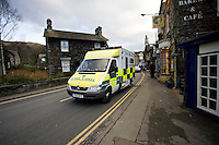 Ambulance on Emergency call driving through traffic in Ambleside Cumbria UK. This image may only be used to portray the subject in a positive manner..©shoutpictures.com..john@shoutpictures.com