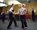London, UK. 23.02.2015. A Lindy Hop dance class is held at Portcullis House, Westminster, hosted by DanceUK, with MPs as guests, to launch the Dance Manifesto.  Strictly's Jenny Thomas and Robin Windsor teach the class, whilst Bic Graham, from The Lindy Club,  DJs. Picture shows: Dancers and MPs enjoying the social dancing. Photograph © Jane Hobson.
