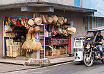 Buri products hang for sale in a Lucban shop.