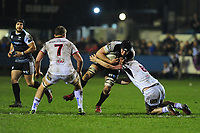 Lloyd Ashley of Ospreys is tackled by Nick Timoney of Ulster during the Guinness Pro14 Round 15 match between the Ospreys and Ulster Rugby at Morganstone Brewery Field in Bridgend, Wales, UK. Friday 15 February 2019