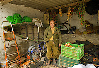 Julio Escudero, a former fisherman who has been working all his life long in the national park of Las Tablas de Daimiel in Ciudad Real stands in a fisherman hut on November 16, 2009. The European Union launched an investigation into Spanish wetland that has turned bone dry through mismanagement of water resources  from areas where fish once swam. The EU wants the Spanish government to explain how it plans to save Las Tablas de Daimiel National Park.The park, one of Spain's few wetlands, is classified as a UNESCO biosphere site and an EU-protected area because of its birdlife. But it has been drying up for decades, largely because of wells dug by farmers on the edges of the park to tap an aquifer that feeds the wetland's lagoons. Many of the wells are illegal. Environmentalists call this case a particularly glaring example of how a natural resource can be abused. (c)Pedro ARMESTRE