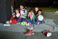 Pictured: Refugee children take shelter in a disused warehouse in Piraeus Port Sunday 28 February 2016<br /> Re: Hundreds of migrants have arrived from the Greek islands to Piraeus Port, Greece