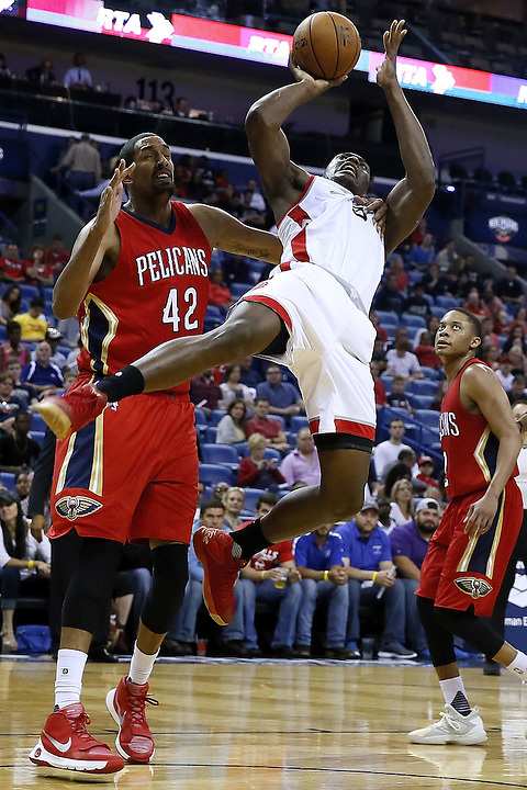 NEW ORLEANS, LA - MARCH 26:  Alexis Ajinca #42 of the New Orleans Pelicans fouls Bismack Biyombo #8 of the Toronto Raptors during a game at the Smoothie King Center on March 26, 2016 in New Orleans, Louisiana. NOTE TO USER: User expressly acknowledges and agrees that, by downloading and or using this photograph, User is consenting to the terms and conditions of the Getty Images License Agreement.  (Photo by Jonathan Bachman/Getty Images)