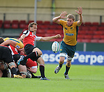 Sean White clears while Australia's Tom Murday attempts to close down. Australia U20 V Canada U20. Junior Rugby World Cup 2008 © Ian Cook IJC Photography iancook@ijcphotography.co.uk www.ijcphotography.co.uk..