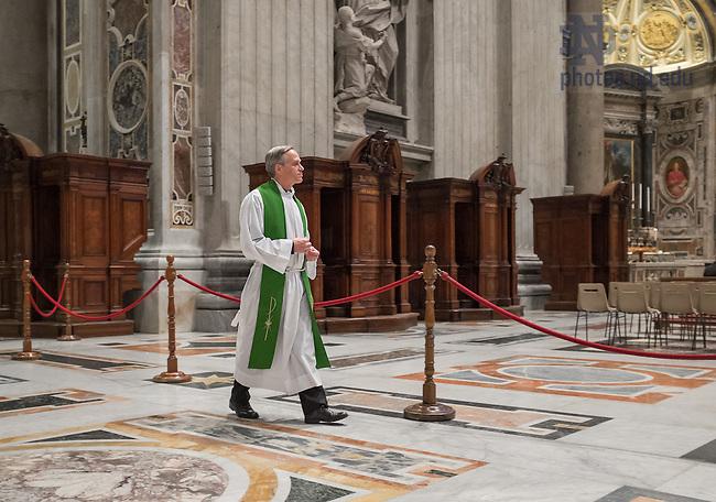 Jan. 30, 2014; Rev. John Jenkins, C.S.C. walks into St. Peter's Basilica at The Vatican.<br /> <br /> Photo by Matt Cashore/University of Notre Dame