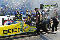 Jul, 8, 2011; Joliet, IL, USA: NHRA top fuel dragster driver Morgan Lucas and crew members during qualifying for the Route 66 Nationals at Route 66 Raceway. Mandatory Credit: Mark J. Rebilas-