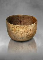 Neolithic terracotta bowl. Catalhoyuk collection, Konya Archaeological Museum, Turkey. Against a grey background