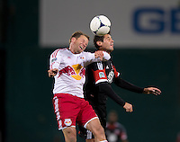 Branko Boskovic (8) of D.C. United goes up for a header with Teemu Tainio (6) of New York Red Bulls during the game at RFK Stadium in Washington DC. D.C. United tied New York Red Bulls, 1-1.