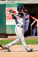 Jesse Winker (23) of the Billings Mustangs follows through on his swing against the Orem Owlz at Brent Brown Ballpark on July 22, 2012 in Orem, Utah.  The Mustangs defeated the Owlz 13-8.  (Brian Westerholt/Four Seam Images)