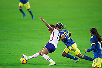 ORLANDO, FL - JANUARY 18: Crystal Dunn #19 of the USWNT battles for the ball during a game between Colombia and USWNT at Exploria Stadium on January 18, 2021 in Orlando, Florida.