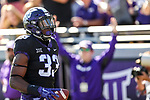 TCU Horned Frogs running back Sewo Olonilua (33) in action during the game between the Baylor Bears and the TCU Horned Frogs at the Amon G. Carter Stadium in Fort Worth, Texas.