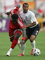 JUNE 15, 2006: Nuremberg, Germany: English defender (3) Ashley Cole pushes  Trinidad & Tobago forward (15) Kenwyne Jones off the ball. England defeated Trinidad & Tobago, 2-0, in their FIFA World Cup Group B match at Franken-Stadion.