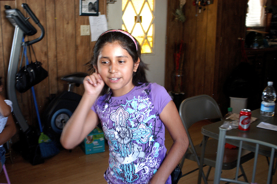AJ Alexander -  Singing and Dancing at home, Kathy Figueroa was just nine years old in 2009 when her parents both undocumented Mexico immigrants were arrested by the Maricopa County Sheriff's Deputies in a raid at a Phoenix car wash where they worked at..Photo by AJ Alexander