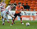 :: DUNDEE UTD'S DANNY SWANSON GETS AWAY FROM HAMILTON'S JIM MCALISTER ::