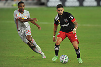 WASHINGTON, DC - SEPTEMBER 12: Junior Moreno #5 of D.C. United battles for the ball with Jason Pendant #24 of New York Red Bulls during a game between New York Red Bulls and D.C. United at Audi Field on September 12, 2020 in Washington, DC.