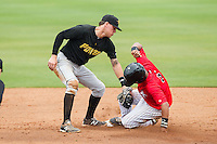 Cleuluis Rondon (5) of the Kannapolis Intimidators steals second base ahead of the tag by West Virginia Power shortstop JaCoby Jones (10) at CMC-Northeast Stadium on April 30, 2014 in Kannapolis, North Carolina.  The Intimidators defeated the Power 2-1 in game one of a double-header.  (Brian Westerholt/Four Seam Images)