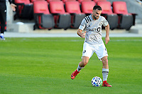 WASHINGTON, DC - NOVEMBER 8: Rudy Camacho #4 of Montreal Impact moves the ball during a game between Montreal Impact and D.C. United at Audi Field on November 8, 2020 in Washington, DC.
