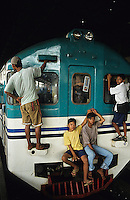 INDONESIA Java Jakarta, young boys surfing at local city train / Indonesien Jakarta, Jugendliche surfen am S-Bahn Zug