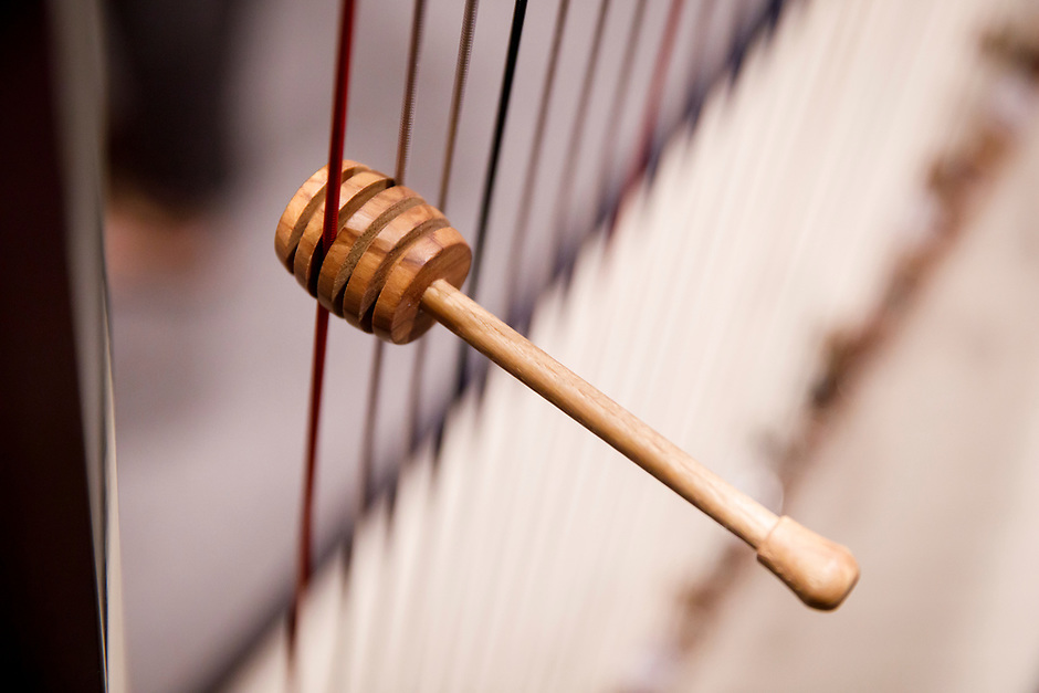 A honey dipper hangs from the strings of a harp after the Composition Forum at the 11th USA International Harp Competition at Indiana University in Bloomington, Indiana on Monday, July 8, 2019. (Photo by James Brosher)