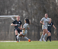 LOUISVILLE, KY - MARCH 13: Freja Olofsson #8 of Racing Louisville FC and Stefany Ferrer-vanGinkel #21 of West Virginia University battle for the ball during a game between West Virginia University and Racing Louisville FC at Thurman Hutchins Park on March 13, 2021 in Louisville, Kentucky.