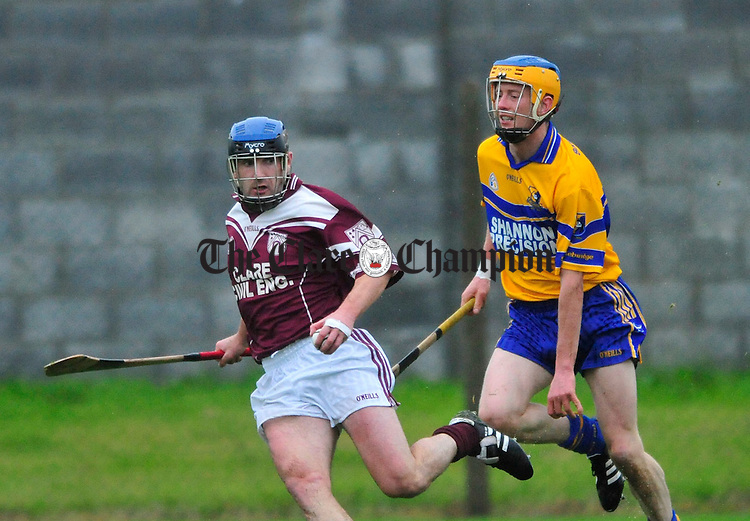 Paul Dullaghan of St Josephs breaks away from Barry O' Connor of Sixmilebridge. Photograph by Declan Monaghan
