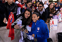 HOUSTON, TX - JANUARY 31: Christen Press #20 of the United States takes a selfie with fans during a game between Panama and USWNT at BBVA Stadium on January 31, 2020 in Houston, Texas.