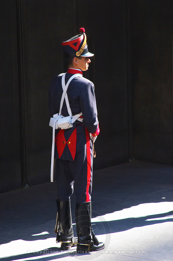 One of the honour guards at the mausoleum of General Artigas on Plaza Independencia Independence Square, dressed in old style parade uniform in red blue and white with leather riding boots and sabre. Montevideo, Uruguay, South America