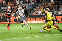 6th April 2021; Bankwest Stadium, Parramatta, New South Wales, Australia, Australian A League football, Western Sydney Wanderers versus Central Coast Mariners; Jack Clisby of Central Coast Mariners shoots as Daniel Margush of Western Sydney Wanderers comes out to make the save