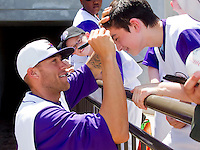 Brandon Kloess #28 of the Winston-Salem Dash autographs a young fan's forehead prior to the Carolina League game against the Wilmington Blue Rocks at BB&T Ballpark on April 24, 2011 in Winston-Salem, North Carolina.   Photo by Brian Westerholt / Four Seam Images