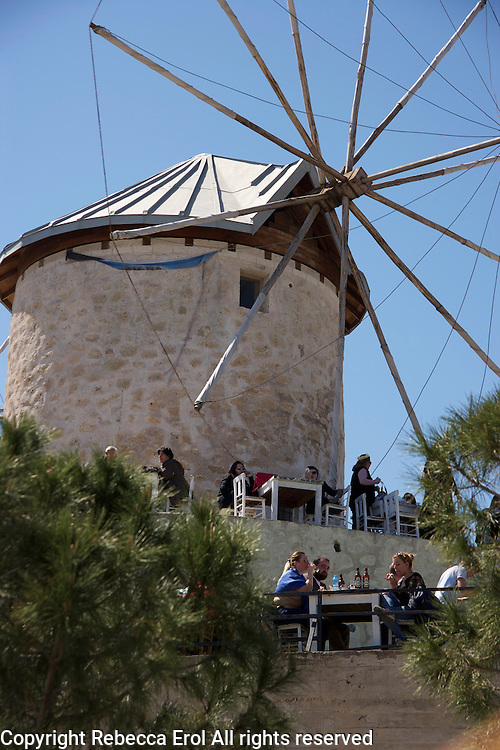 Old windmills are in use as cafes in Alacati, Turkey