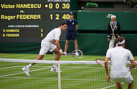 24-06-13, England, London,  AELTC, Wimbledon, Tennis, Wimbledon 2013, Day one, Victor Hanescu (ROU) vs Roger Federer (SUI)<br /> <br /> <br /> <br /> Photo: Henk Koster