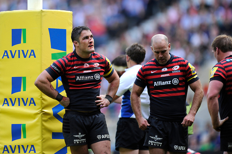 Brad Barritt and Charlie Hodgson of Saracens look dejected after losing the Aviva Premiership Rugby Final to Northampton Saints during the Aviva Premiership Final between Saracens and Northampton Saints at Twickenham Stadium on Saturday 31st May 2014 (Photo by Rob Munro)